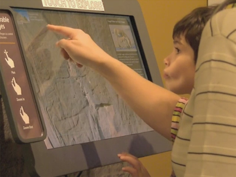 Kids using the interactive kiosk.